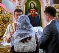Proud parents Halya & Sasha w/ Mark & the priest